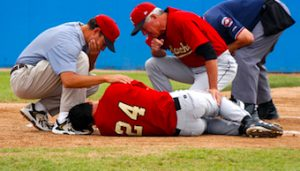 athlete suffers spinal injury from collision